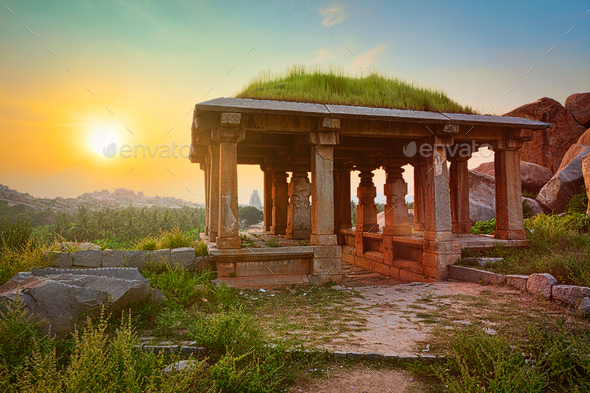 Ancient ruins in Hampi on sunset. India - Stock Photo - Images