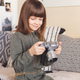 Child girl holding a retro camera sitting on bed at home - PhotoDune Item for Sale