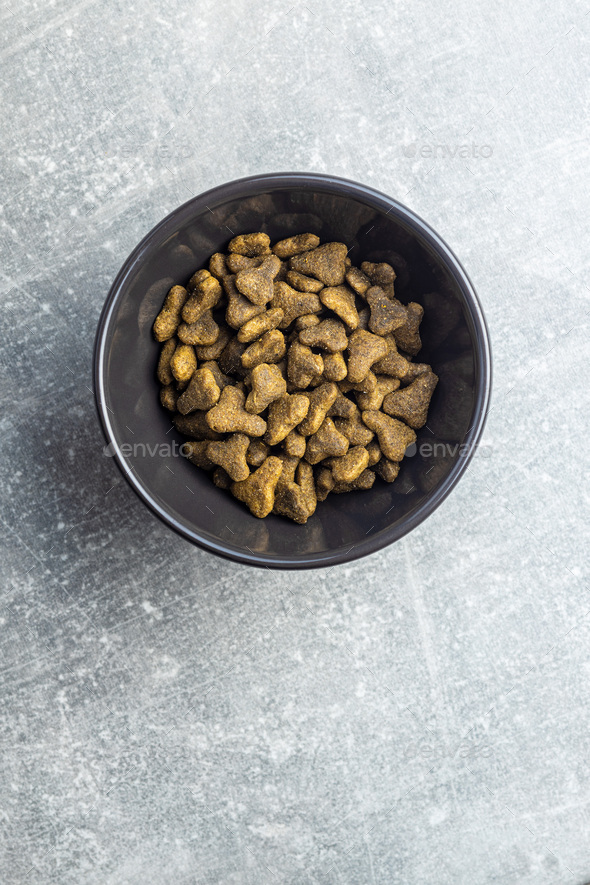 Dry pet food. Kibble dog or cat food. - Stock Photo - Images