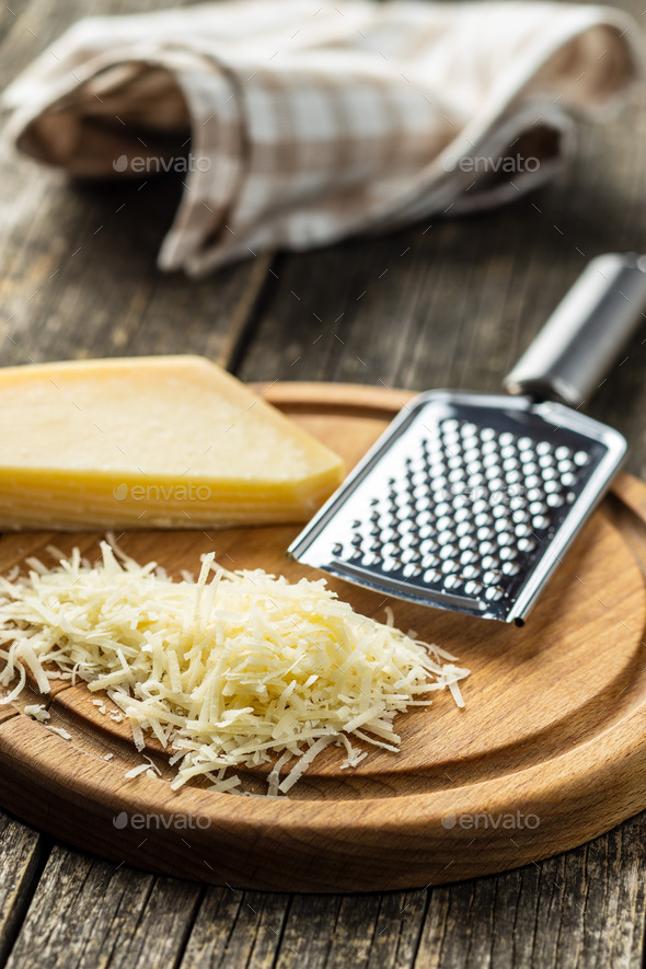 Tasty grated cheese. Parmesan cheese. - Stock Photo - Images