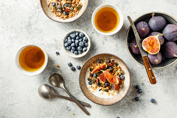 Delicious and healthy Breakfast with homemade granola, fruits and berries - Stock Photo - Images
