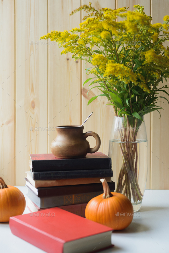 autumn still life with books, pumpkins, cup, solidago bouquet - Stock Photo - Images
