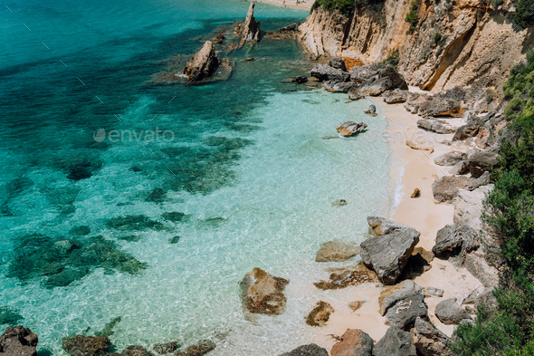 Hidden empty beach with pure clear turquoise sea water near white rock cliffs located in famous - Stock Photo - Images