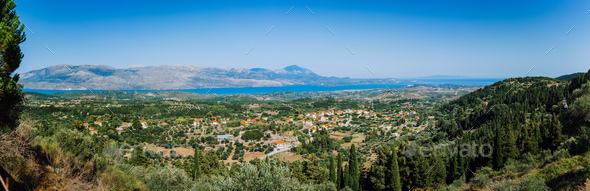 Ultra wide panormaic view of idyllic valley town with red roofs on mediterranean island. Olive - Stock Photo - Images