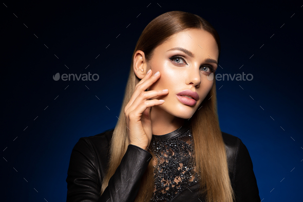 Beauty fashion portrait on blue wall background - Stock Photo - Images