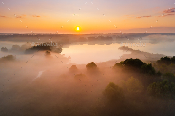 Beautiful misty dawn in the spring on the river - Stock Photo - Images