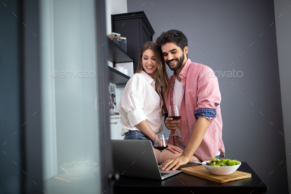 Couple enjoying breakfast time together at home - Stock Photo - Images