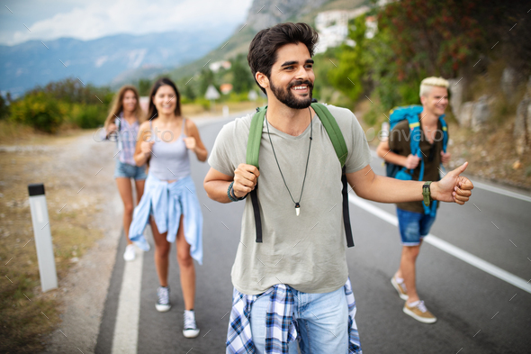 Group of friends backpackers walking and traveling outdoor - Stock Photo - Images