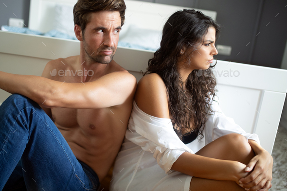 Couple having arguments and sexual problems in bed - Stock Photo - Images