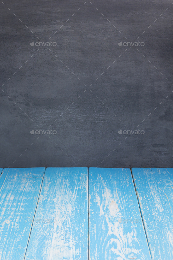 empty blue wooden table in front - Stock Photo - Images