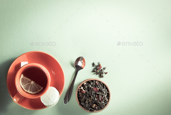 cup of tea at light green paper - Stock Photo - Images