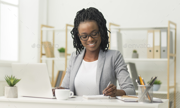 Black Office Girl Sitting At Laptop Taking Notes At Work - Stock Photo - Images