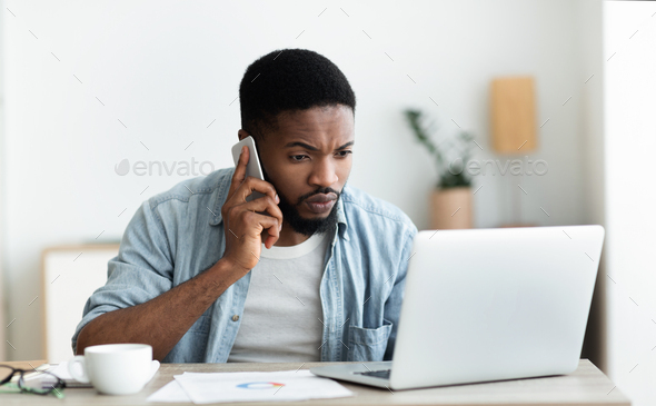 Millennial guy dialing technical support cause his internet is down - Stock Photo - Images