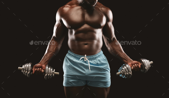 Workout with dumbbells, african athlete holding barbells - Stock Photo - Images