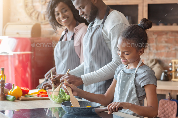 Lovely vegan family making healthy dinner together - Stock Photo - Images