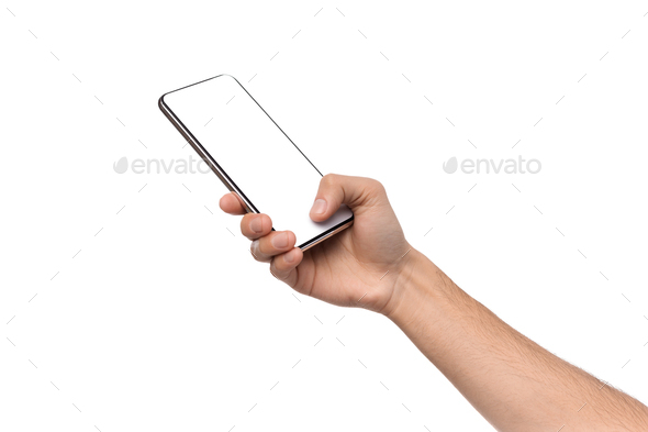 Male hand holding and touching blank smartphone screen with thumb - Stock Photo - Images