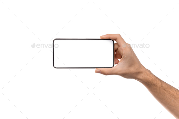 Man's hand holding modern smartphone with blank screen for mockup - Stock Photo - Images