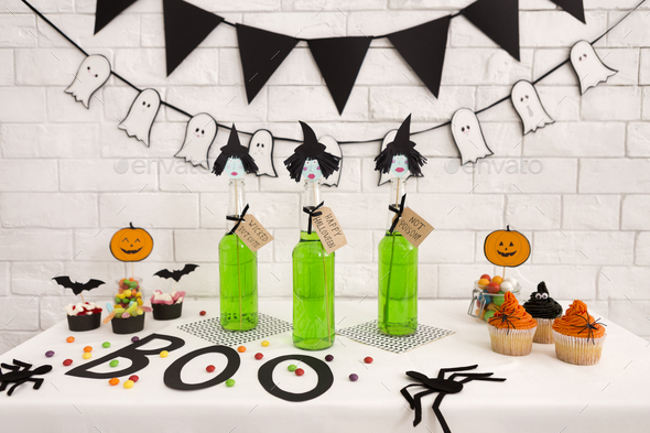 Toxic green fresh cocktails with cupcakes on background - Stock Photo - Images