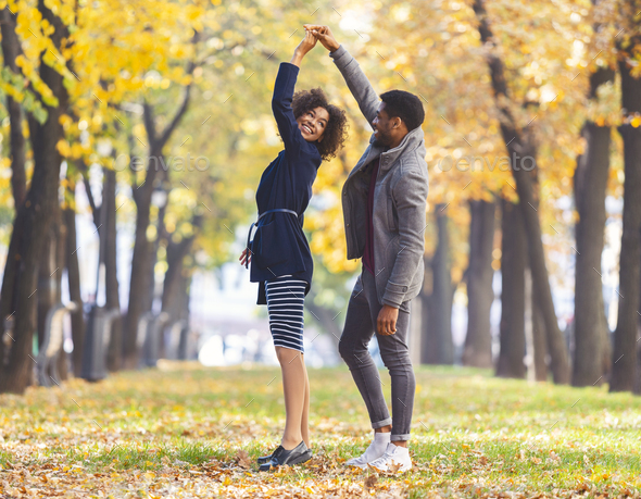 Couple in love dancing in autumn park - Stock Photo - Images