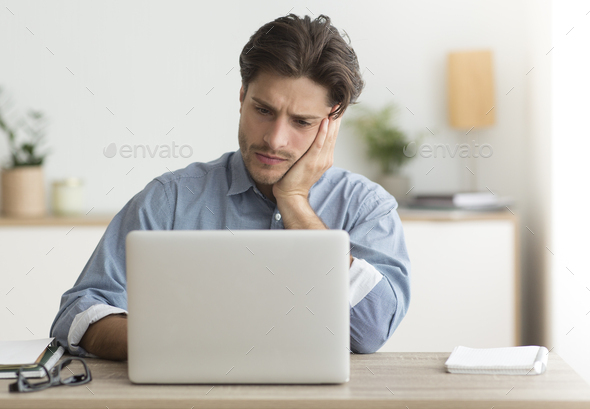Unhappy Office Manager Sitting At Laptop Working In Office - Stock Photo - Images