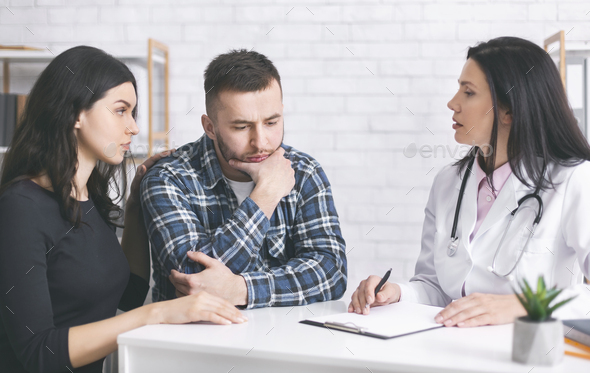 Upset thoughtful man heard bad diagnosys, listening to doctor at clinic - Stock Photo - Images