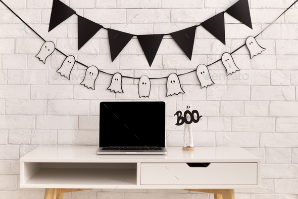 Halloween decorations in modern office with laptop - Stock Photo - Images