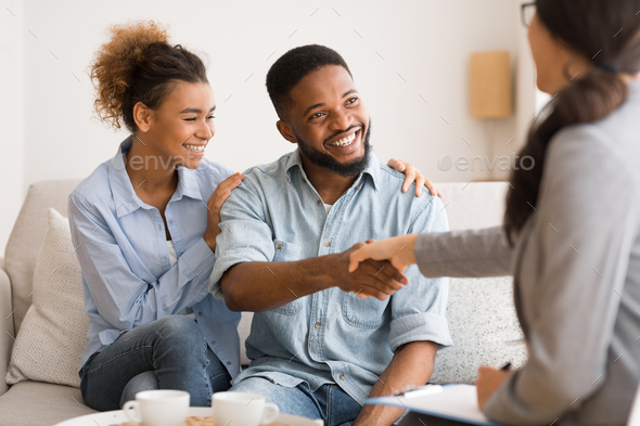 Young African American Couple Handshaking With Marriage Counselor After Therapy - Stock Photo - Images