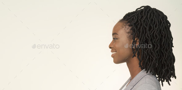 Studio Portrait Of Smiling African American Businesswoman, Side View, Panorama - Stock Photo - Images