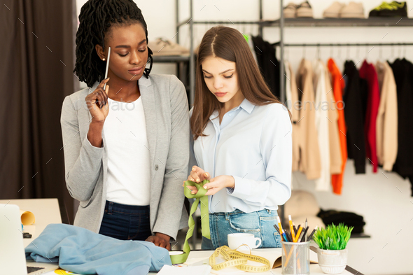 Two Tailors Working On Collection In Fashion Design Workshop - Stock Photo - Images