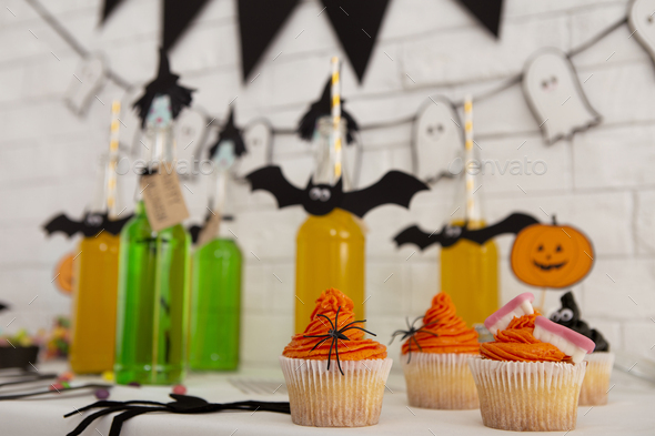 Close up of Halloween drinks and food for sweet party in office - Stock Photo - Images