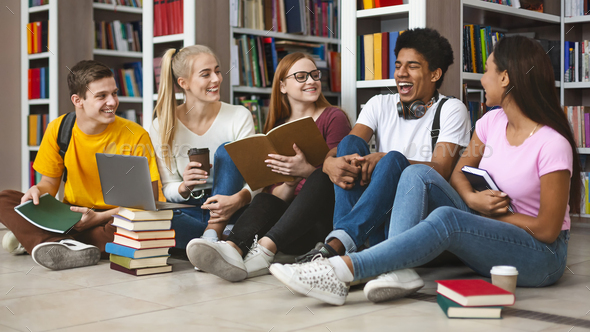 Group of teenage friends laughing while preparing for exams - Stock Photo - Images