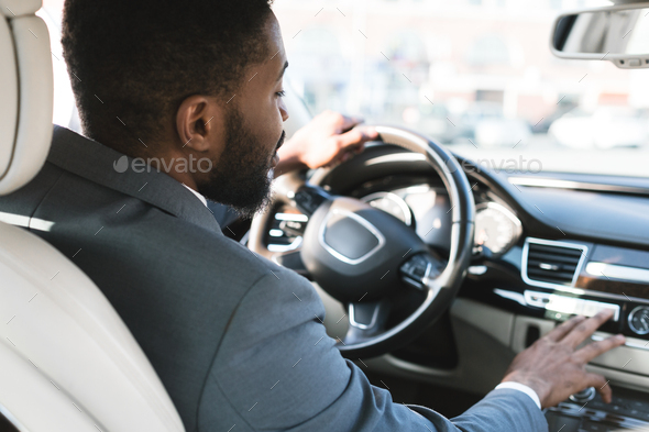 Driving with comfort. Businessman touching dashboard in car - Stock Photo - Images