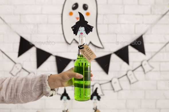 Creative cocktail in shape of witch in woman hand - Stock Photo - Images