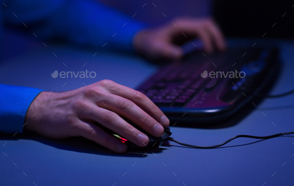Man playing video games on desktop pc at home - Stock Photo - Images