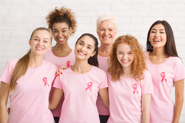 Ladies In Pink Ribbon T-Shirts Posing On White Background Indoor - Stock Photo - Images