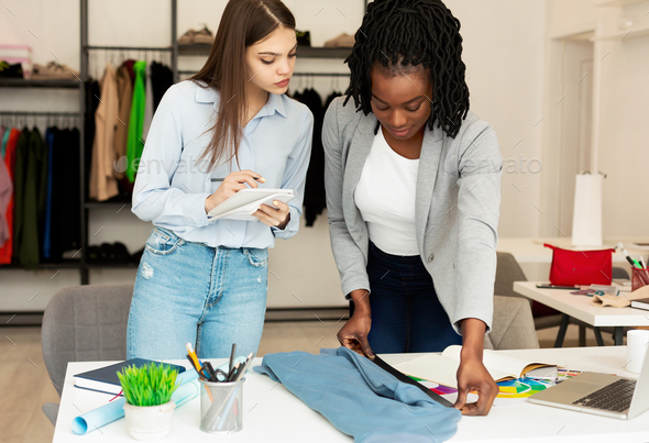 Diverse Designers Working On Clothing Line In Atelier - Stock Photo - Images