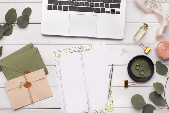 Wedding checklist with places for ticks, laptop with Internet - Stock Photo - Images