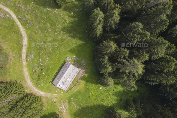 aerial view over a mountain house surrounded by nature - Stock Photo - Images