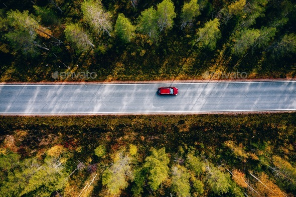 Aerial view of road in beautiful autumn forest in rural Finland. - Stock Photo - Images