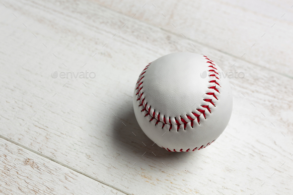 White baseball ball stitched with red thick. - Stock Photo - Images