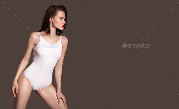 Sporty Slim Woman In White Body. Gray Background. - Stock Photo - Images