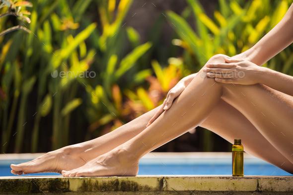 Young Slim Beautiful Woman In Bikini Applying Oil - Stock Photo - Images