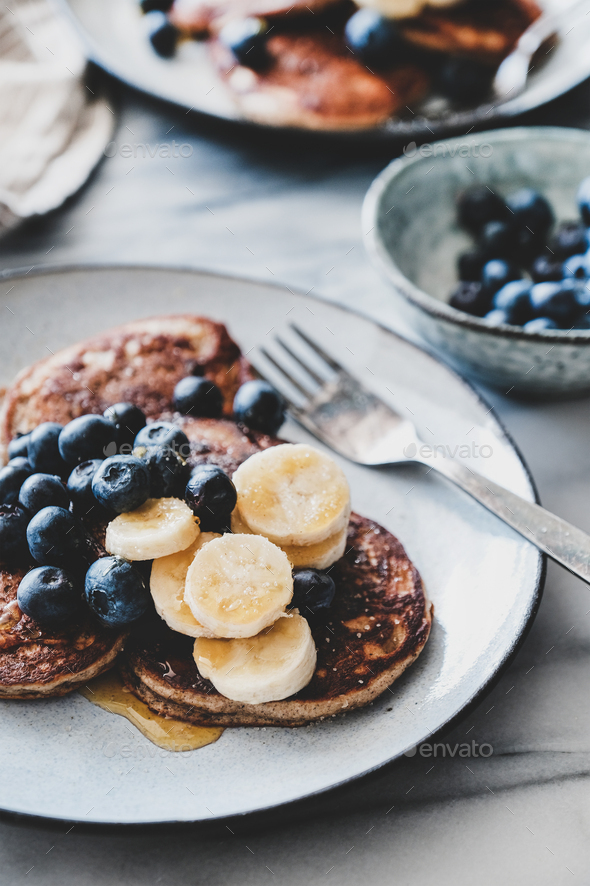 Banana pancakes with bluelerry and honey over marble table - Stock Photo - Images