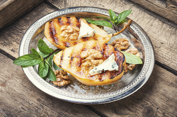 Grill pear with walnut - Stock Photo - Images