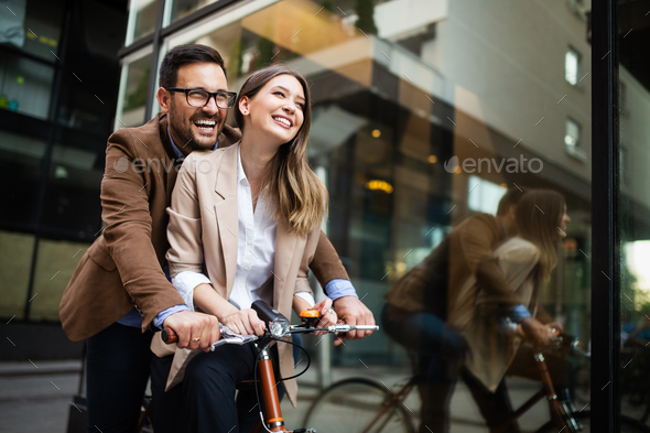 Attractive young business couple embracing at street - Stock Photo - Images