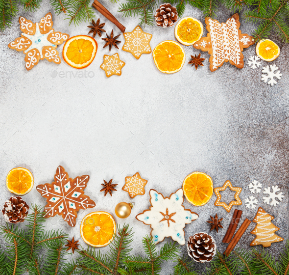 Christmas ginger cookies in the shape snowflakes, dried orange, star anise and fir cones - Stock Photo - Images