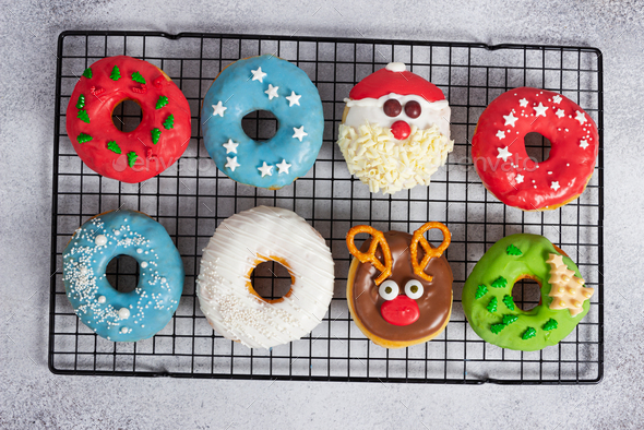 Set of Christmas donuts on baking rack on gray stone background. - Stock Photo - Images