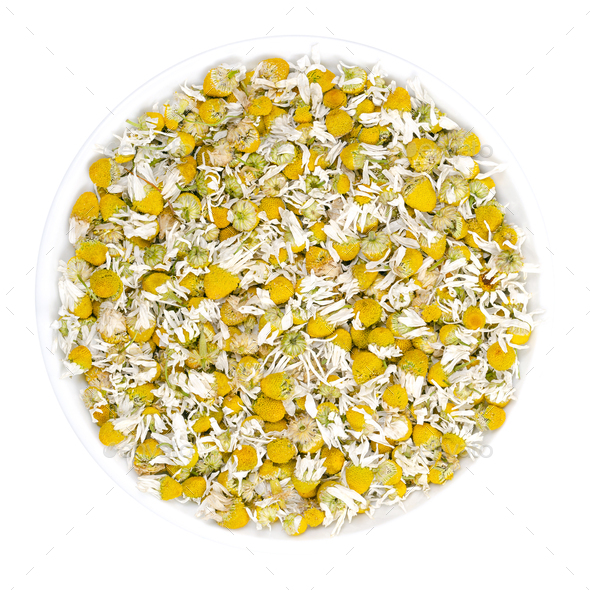 Dried chamomile blossoms, camomile tea in white bowl - Stock Photo - Images