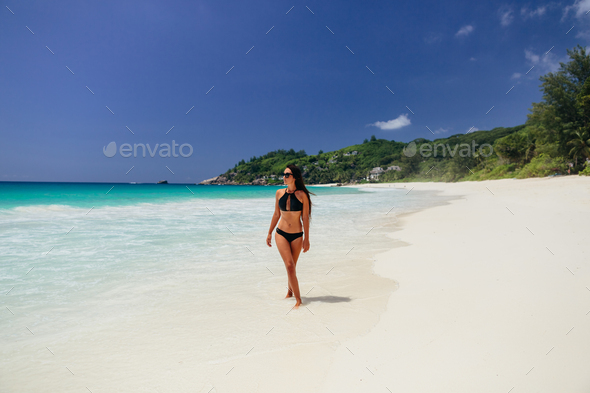 woman relax on beach of tropical island - Stock Photo - Images