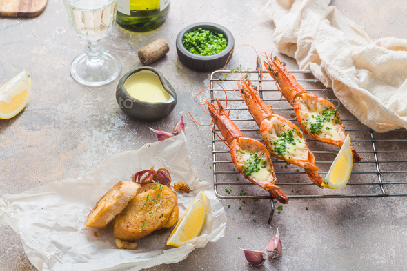 Grilled prawns with sauce and spring onion, copy space - Stock Photo - Images